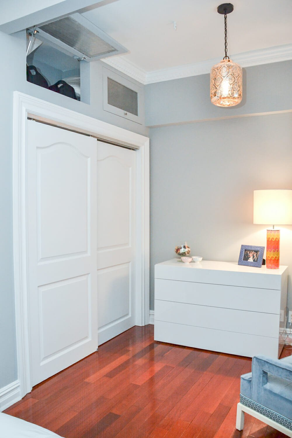 Storage nook above closet in master bedroom