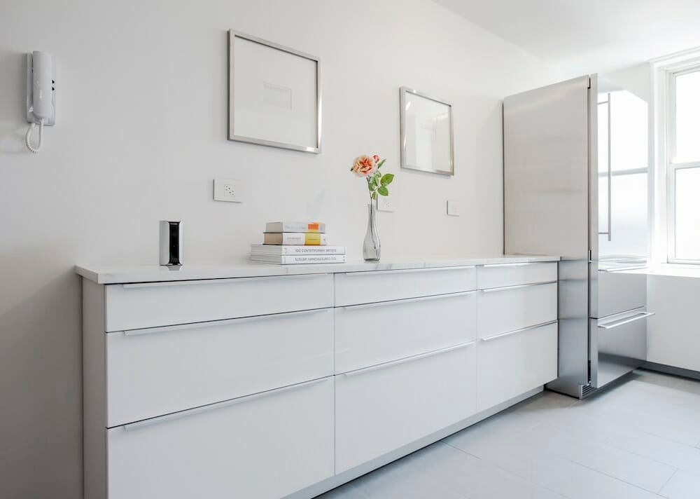 A White Ikea Kitchen Goes For A Touch Of Shine
