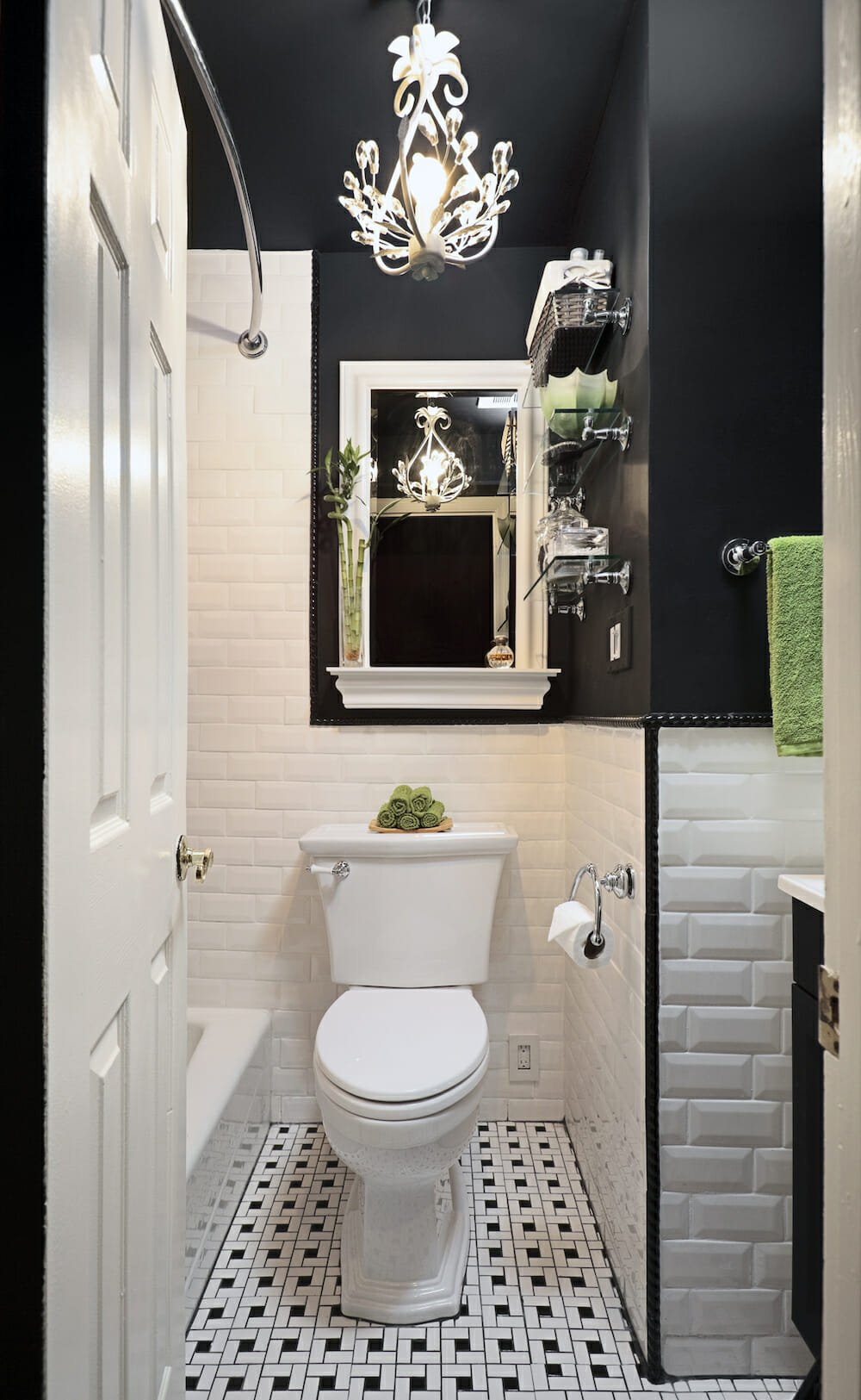 A modern black and white bathroom with basketweave tile