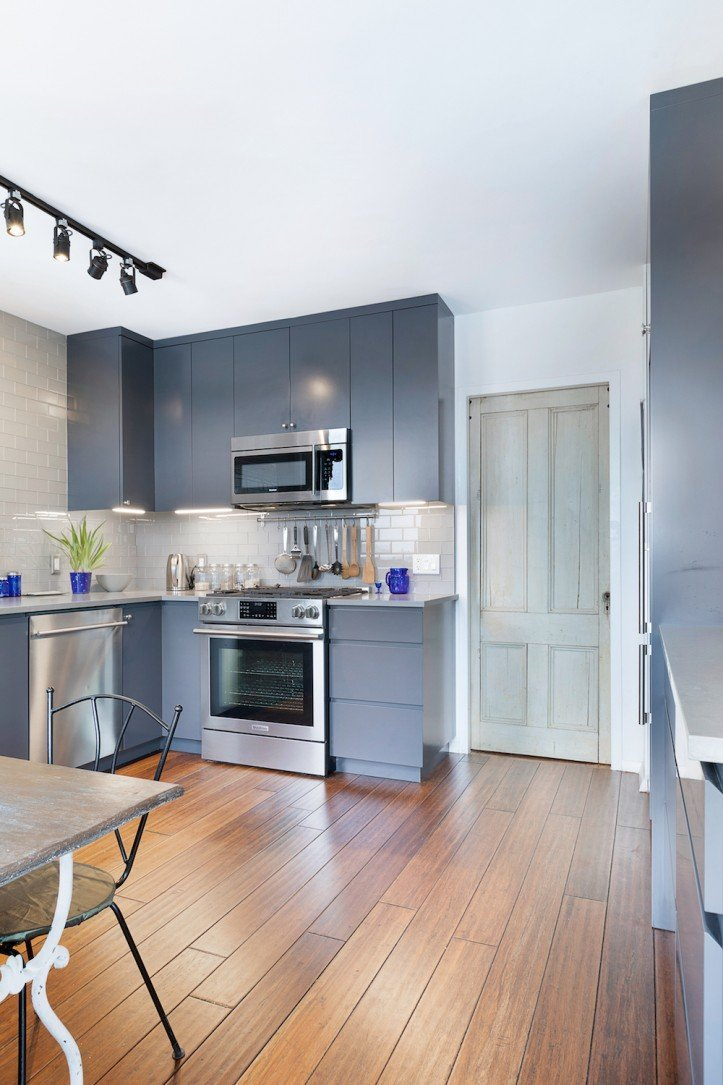 apartment renovation, clinton hill co-op, kitchen, hardwood floors, subway tile, stainless steel appliances, sliding door, spot lighting