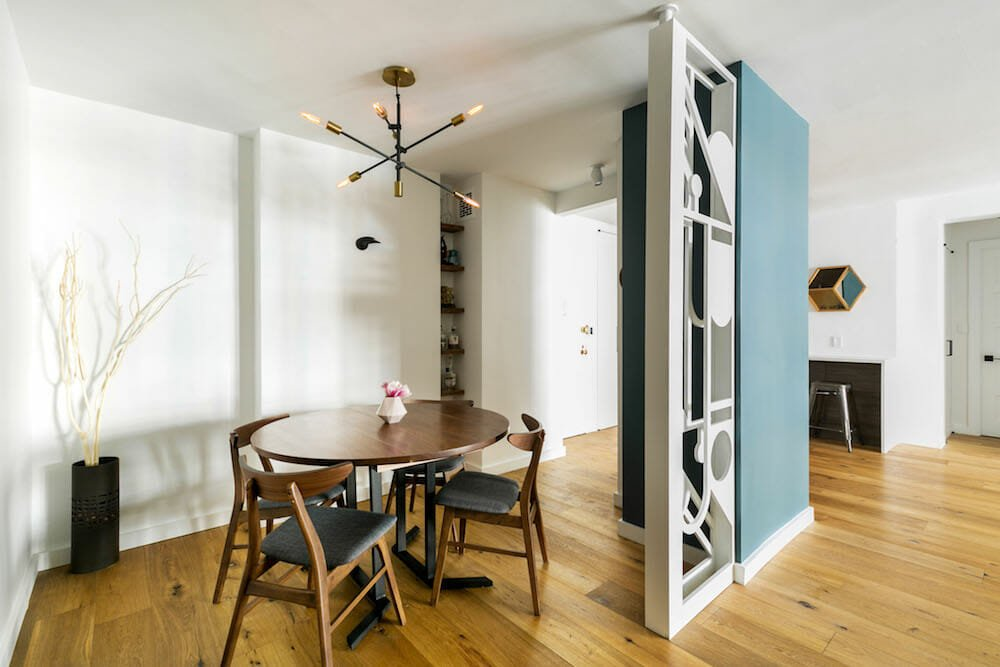 When combining two apartments, this couple had to incorporate an unmovable gas riser into their room design