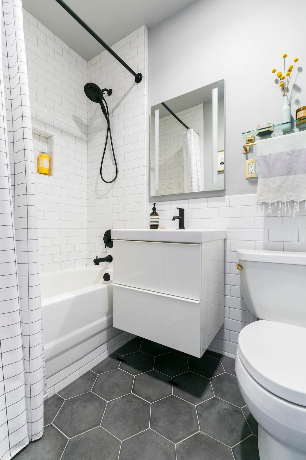apartment renovation, prospect heights co-op, bathroom, hexagon floor tile, subway tile, matte black accents, lighted medicine cabinet, wall-hung sink