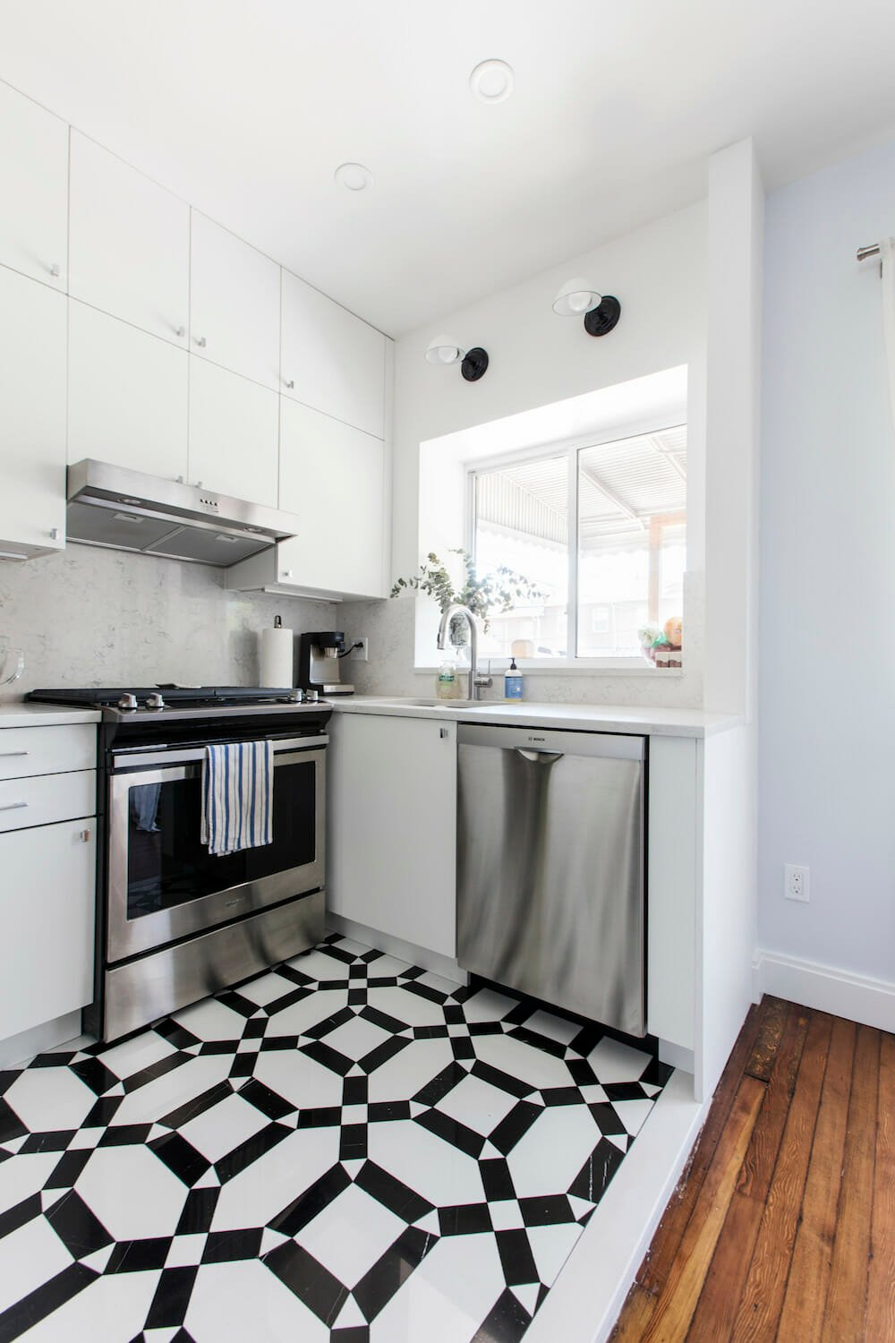 small kitchen with white and black tile