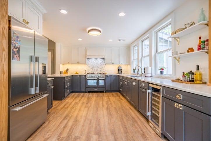 kitchen renovation, Westchester, kitchen, hardwood floors, blue cabinets, shaker-style cabinets, marble countertop, stainless steel appliances, backsplash tile, open shelving