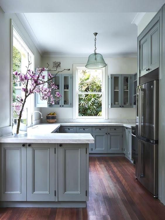 kitchen peninsula, dark hardwood, stainless steel appliances, upper cabinetry