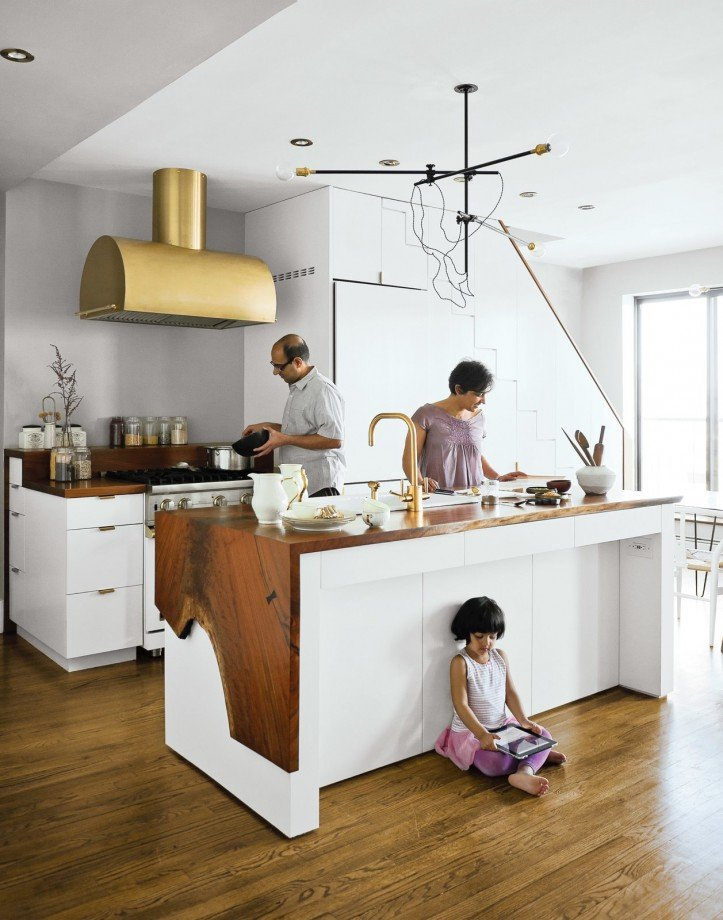 kitchen, waterfall island, live-edge, wood countertops, white cabinets, brass accents, pendant lighting