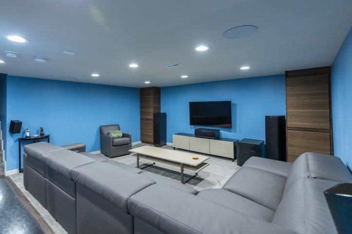 Philadelphia, basement renovation, home renovation, design, gray couch, blue walls, basement renovation before and after