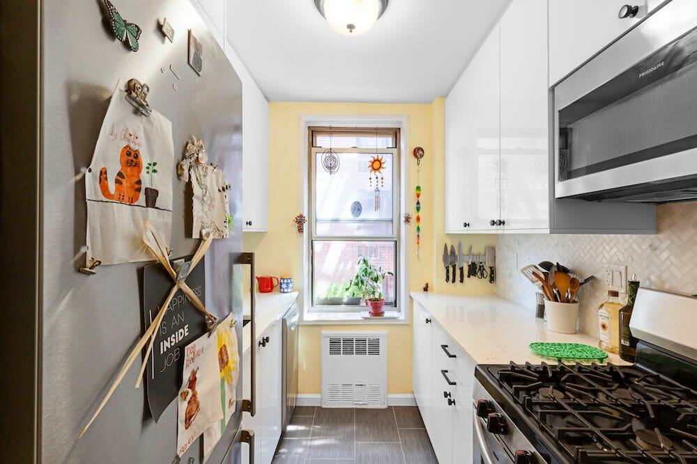 small kitchen with white cabinets