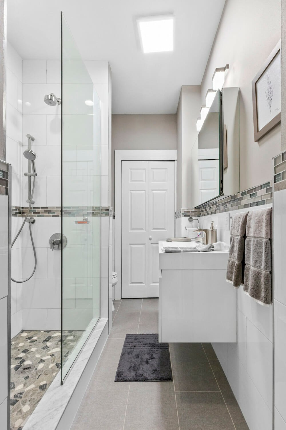 The new walk-in shower lights up the space and prioritizes safety
