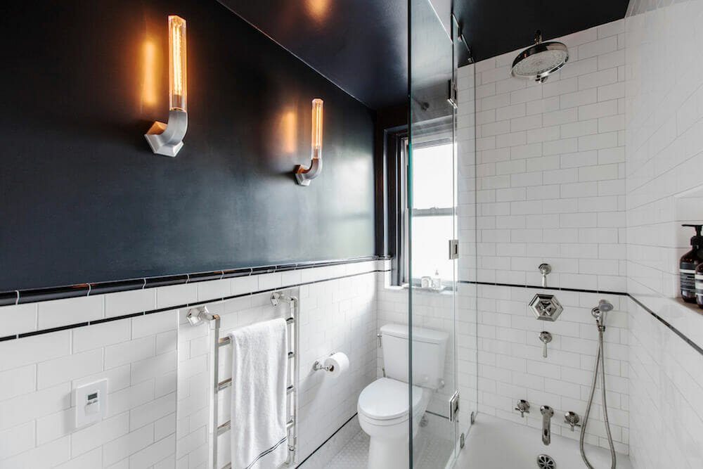 Image of a renovated bathroom with towel warmer and bathtub