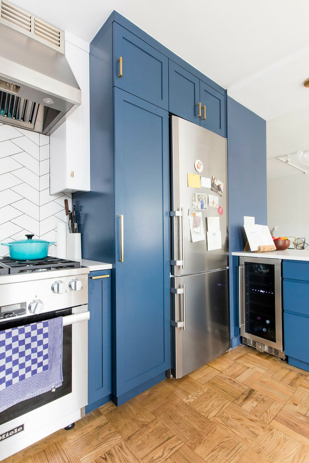 Image of a kitchen with a small wine fridge in corner