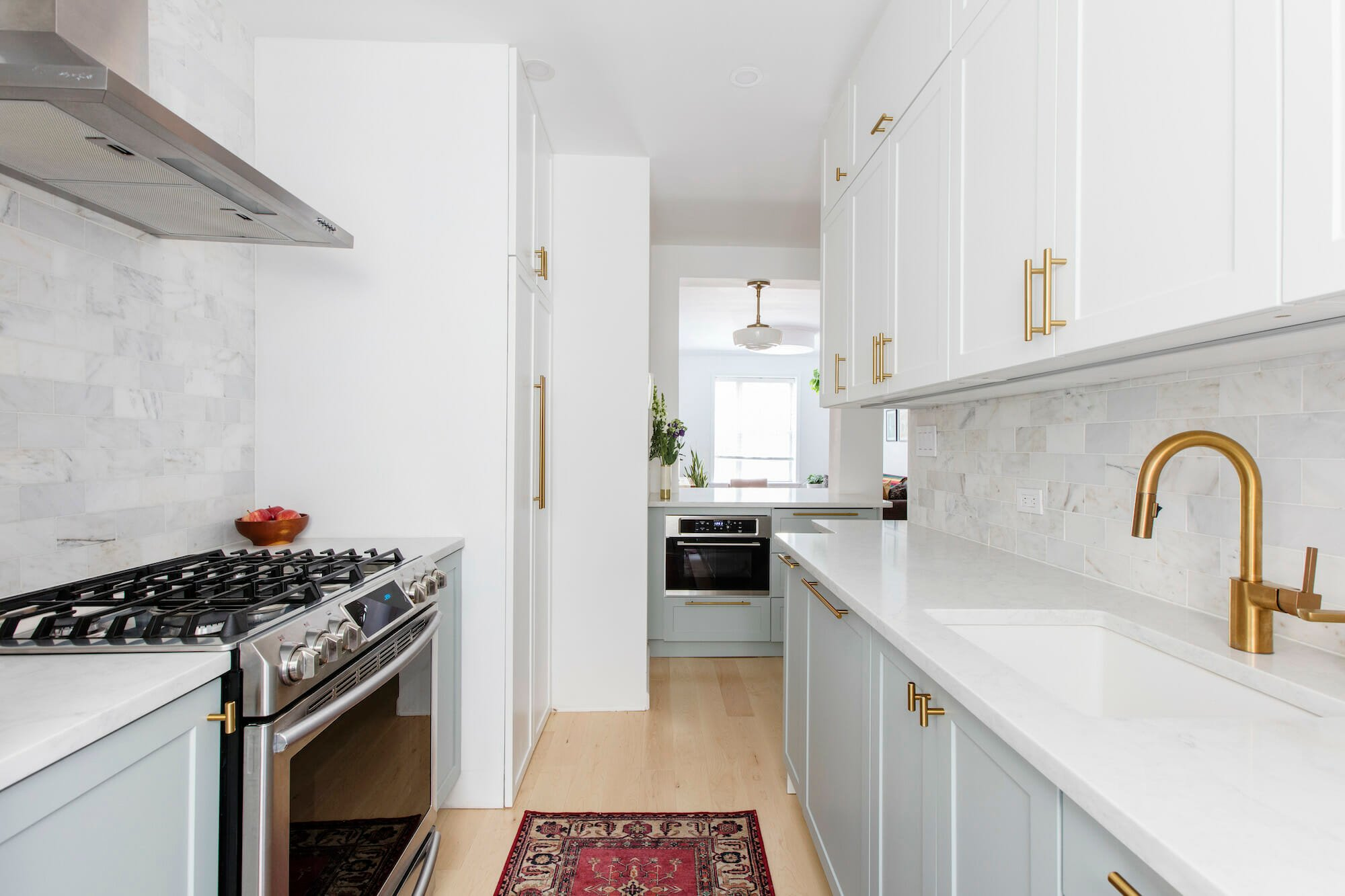 kitchen after renovation, white cabinets, gold hardware