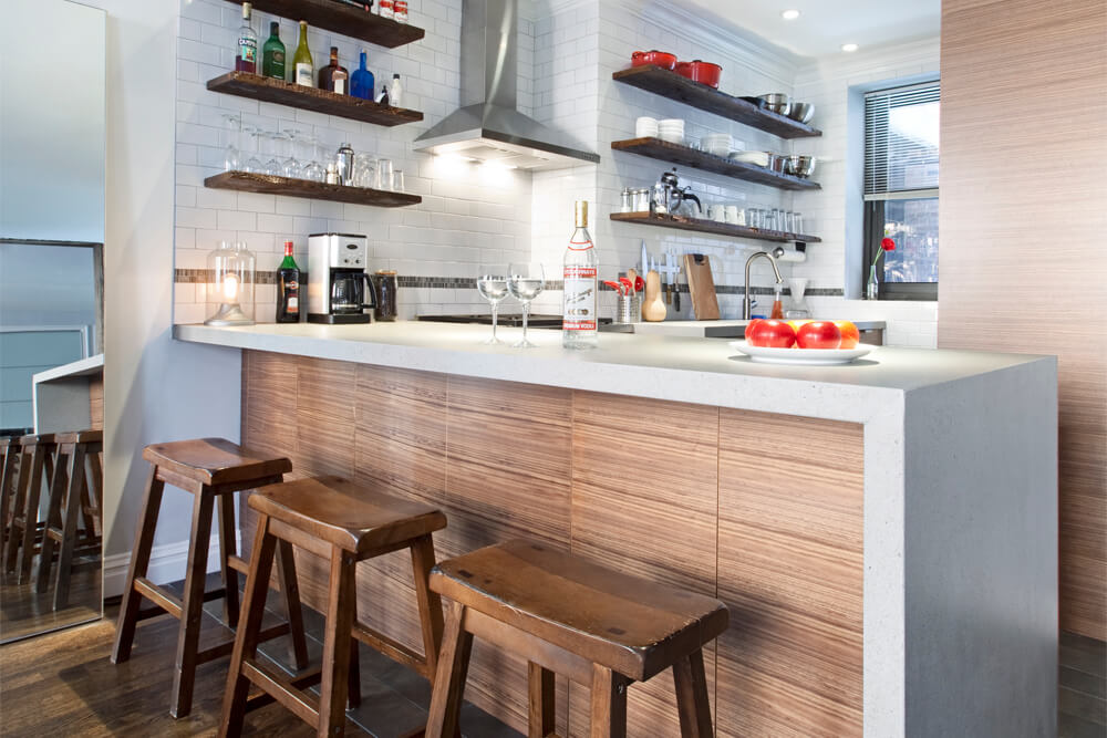 Image of wooden kitchen peninsula with bar stools