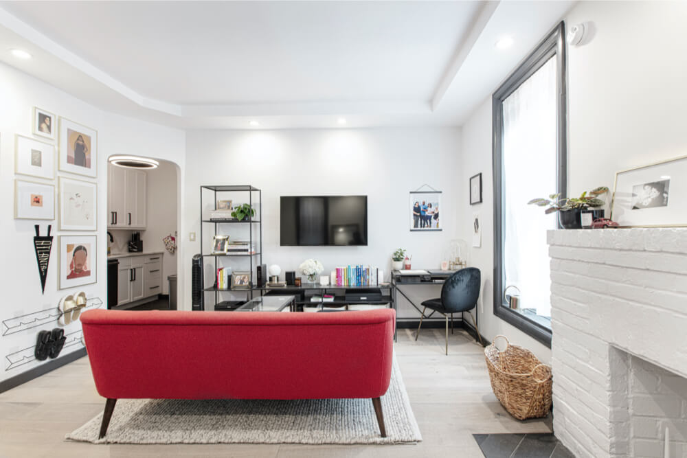 Image of an apartment living room with painted fireplace and couch