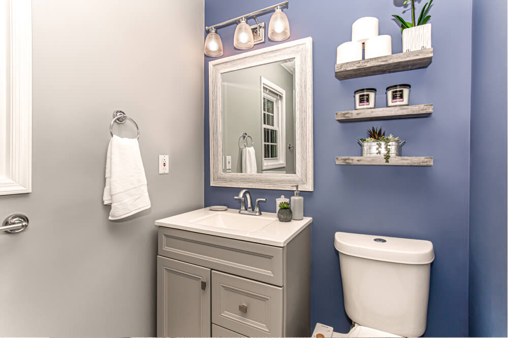 blue bathroom with vanity and toilet