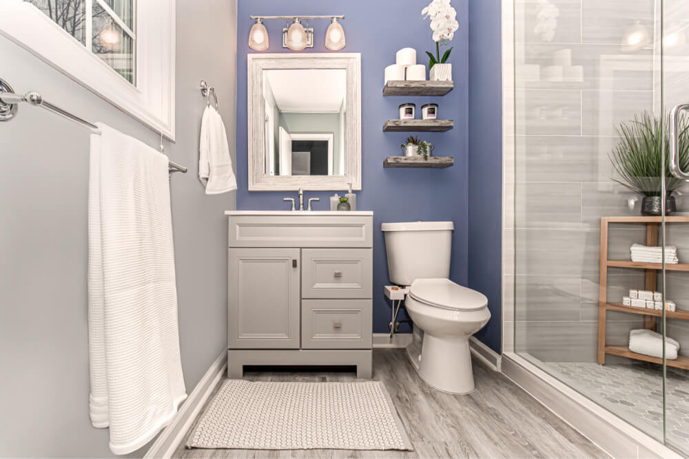 a blue master bathroom with vanity and shower in Atlanta