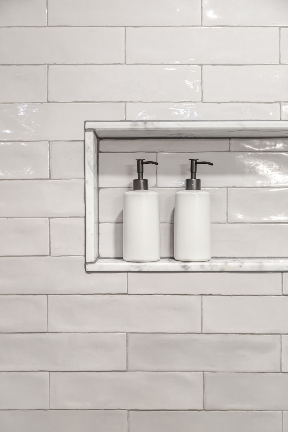 Image of recessed shower niche with white tile