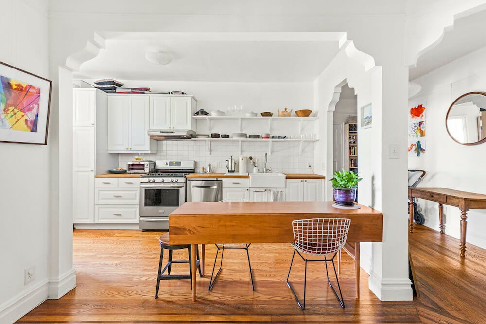 single wall kitchen white white cabinets and wood floors