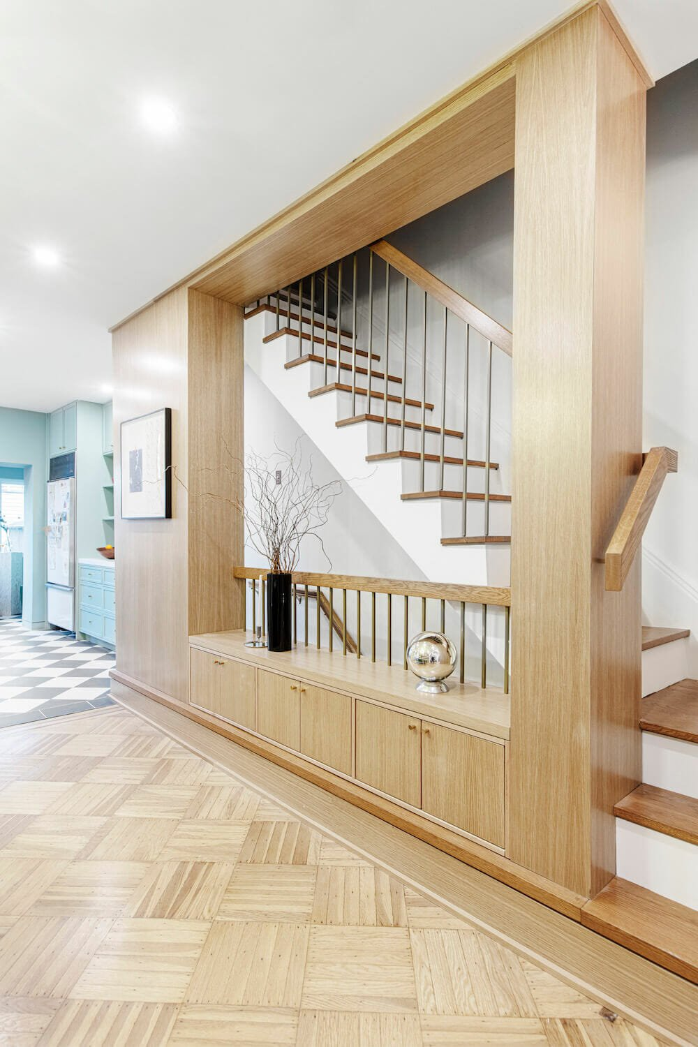 Image of an open stairway with custom storage