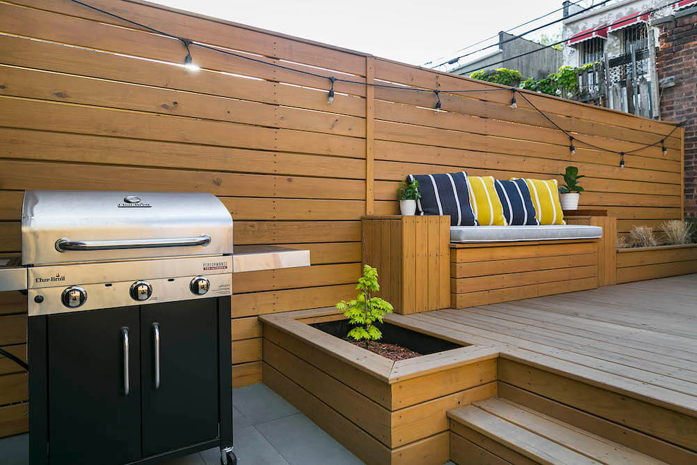 Image of remodeled backyard with grill and seating area