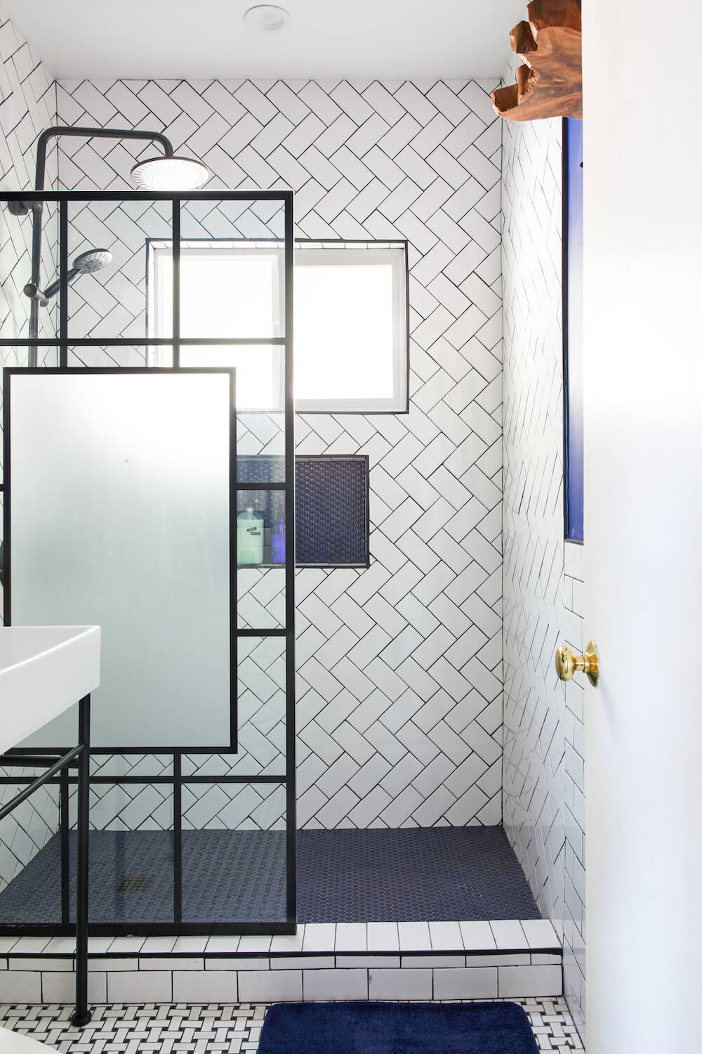 Image of a gut remodel bathroom with walk-in shower and herringbone shower